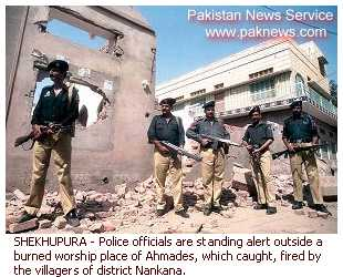 SHEKHUPURA - Police officials are standing alert outside a burned worship place of Ahmadis, destroyed by the villagers.