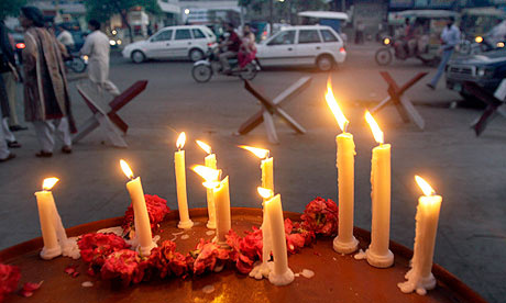 Candles were lit by members of a civil society for victims of the attack on the Ahmadi sect in Lahore. Photograph: KM Chaudary/AP