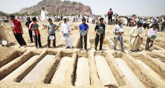 Pakistani Ahmadis bury massacre victims, 2011.
