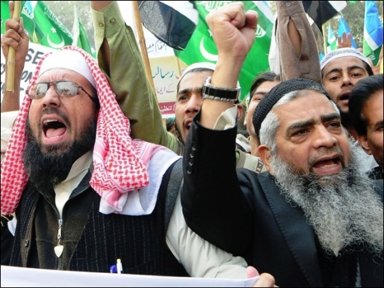 People shout slogans during a rally in Lahore threatening anarchy if the Blasphemy Act is amended. PHOTO: FILE/AFP