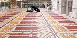 An Ahmadi praying in Mosque
