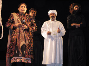 Ajoka Theater founder Madeeha Guahar on stage following a performance in Islamabad of a play about blasphemy. In the antisecular atmosphere following the Punjab governor's assassination, the staging of the play is a rare example of secular society standing up against the intimidation of religious extremists. - Julie McCarthy/NPR
