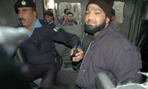Pakistani bodyguard Malik Mumtaz Hussain Qadri sits in a police van after being arrested at the site of a fatal attack on Salmaan Taseer, the governor of Punjab, in Islamabad yesterday. Photograph: Sabir Khan/AFP/Getty Images