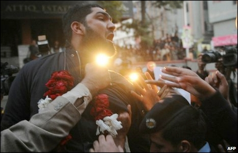 Mobbed and garlanded outside court, Mumtaz Qadri shouts: 'We are ready to sacrifice our life for the prestige of the Prophet Muhammad'