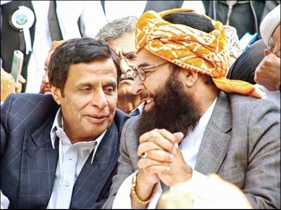 At the Tehrik-i-Namoos Risalat rally held on The Mall yesterday, Pakistan Muslim League-Quaid-i-Azam's Chaudhry Pervaiz Elahi shares a private moment with Maulana Ghafoor Haideri. PHOTO: EXPRESS/WASEEM NIAZ