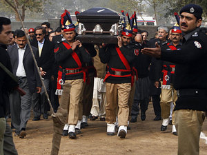 Pakistani police guards carry the coffin of the assassinated governor of Punjab, Salman Taseer, during the funeral procession in Lahore on Jan. 5. - Arif Ali/AFP/Getty Images