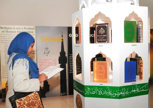 HOLY READING: A visitor at the three-day Quran exhibition titled 'Love for all, Hatred for none' that began in New Delhi on Friday. Photo: V. V. Krishnan