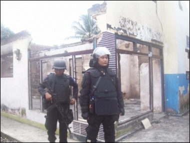 Aftermath: Two members of the police mobile brigade guard houses ransacked by a mob in an Ahmadiyah community center in the Ciampea subdistrict of Bogor, West Java, in this photo taken on Oct. 1, 2010. Non-assimilation into the community by some members of the Ahmadiyah Islamic sect has been cited as among the triggers for the attacks by mainstream Islamic mobs. JP/Theresia Sufa