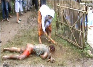 Attack ... a YouTube image of one of the men being beaten to death.