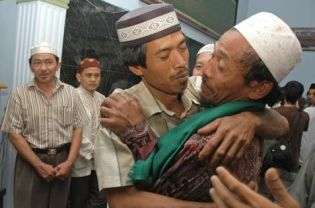Ahmadis hug each other at a mosque near Bogor, West Java, on Tuesday after they shouted out 'Syahadat' as a sign of conversion to Islam. About 13 from 89 members of the sect in that village converted to mainstream Islam just days after a number of attacks on Ahmadis homes. (Antara Photo/Jafkhairi)