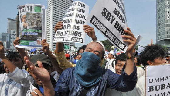 Protesters shout slogans during a rally against the minority Muslim Ahmadiyah sect in Jakarta on February 18, 2011.