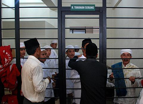 A group of Indonesian Muslims accused of attacking Ahmadiyah followers wait in a cell at a court room in Serang, Indonesia's Banten province July 28, 2011.