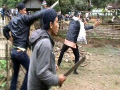 A video grab shows villagers attacking members of the minority Ahmadiyah Islamic sect in Pandeglang, Banten province, on February 6, 2011. Disturbing video emerged February 7 of a bloody religious mob attack in Indonesia that killed three members of a minority Muslim sect, showing extremists beating their victims to death. One member of the sect has been jailed for 6 months for defending himself.
