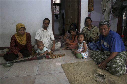 Members of Ahmadiyah sect who fled their homes following the lynching that killed three of the sect followers in February, sit inside their safe house in Banten in the outskirt of Jakarta, Indonesia. (Photo AP)