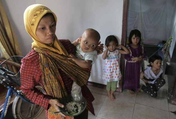 Nurhayati, a member of the Ahmadiyah, a minority Islamic sect, and her child are among those seeking refuge at a safe house in Banten, Indonesia. (Dita Alangkara, Associated Press / September 3, 2011)