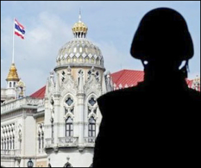 A Thai soldier stands guard close by Government House in Bangkok.